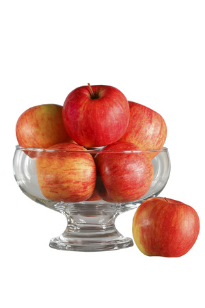 Red apples in fruit bowl isolated on white background. 版權商用圖片
