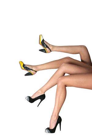 Woman's legs isolated on white background 版權商用圖片