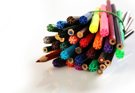 Pencils and markers on a white sheet of paper
