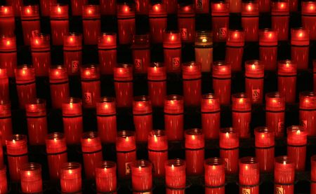Lots of candles in a church in Spain Imagens