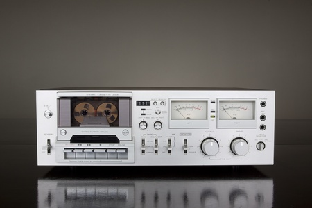 Vintage Stereo Cassette Tape Deck Recorder on the dark background photo