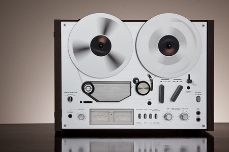 Vintage Reel-to-Reel stereo tape deck recorder closeup on the dark background Stock Photo - 8904875