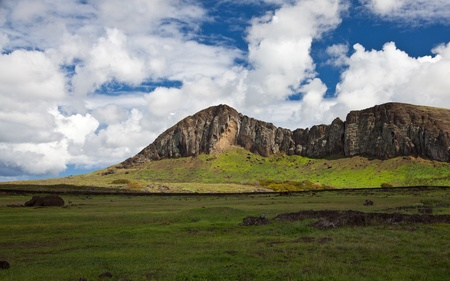 Rano Raraku Mountain, Easter Island, dramatic view of ancient quarry with deep blue sky photo