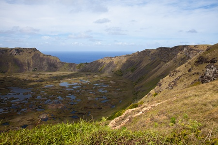 Dramatic Volcano crater near Orongo vilage, Easter Island, grassy walls, sharp rocks, endless ocean Stock Photo - 11326904