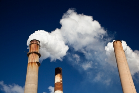 greenhouse gas: White Smoke out of Industrial smokestack Stock Photo