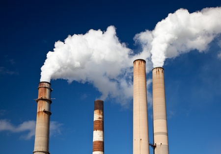 emissions: White Smoke out of Industrial smokestack Stock Photo