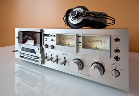 Vintage Stereo Cassette tape deck recorder or player with headphones photo
