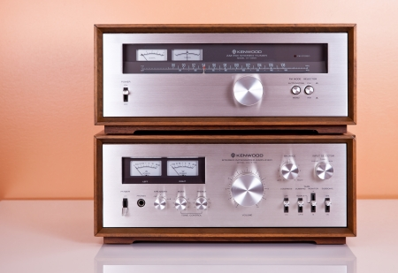 Vintage Stereo Amplifier and Tuner in Wooden Cabinets photo