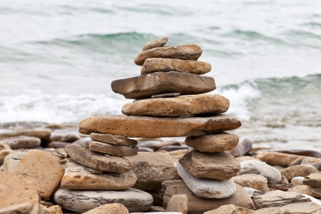 canada aboriginal: Inuksuk or Inkukshuk on the Huron lakeshore