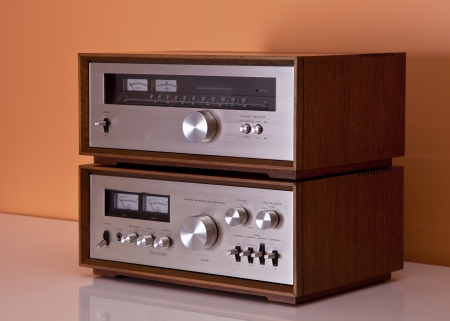 tuner: Vintage hi-fi Stereo Amplifier and tuner in wooden cabinets perspective Stock Photo