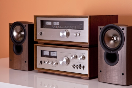 hifi: Vintage hi-fi Stereo Amplifier tuner and speakers in wooden cabinets perspective Stock Photo