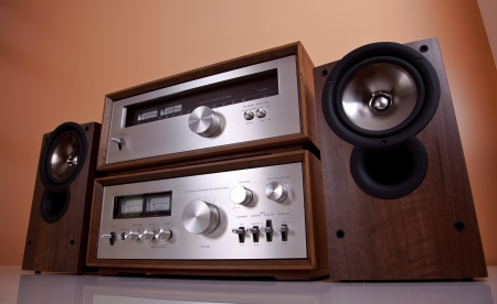 Vintage hi-fi Stereo Amplifier tuner and speakers in wooden cabinets perspective Banco de Imagens