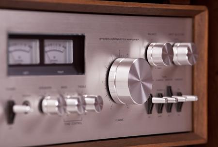 Vintage hi-fi Stereo Amplifier in wooden cabinet perspective, closeup Banco de Imagens