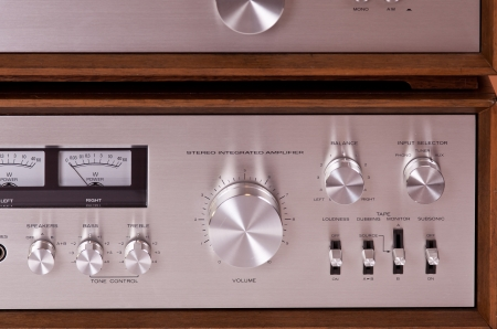 Vintage hi-fi Stereo Amplifier in wooden cabinet front