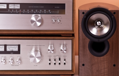 Vintage hi-fi Stereo Amplifier tuner and speakers in wooden cabinets, front Banco de Imagens