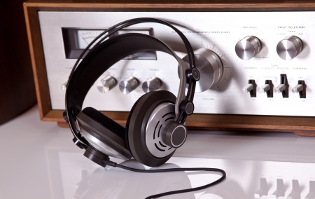 Headphones connected to audio stereo devices closeup