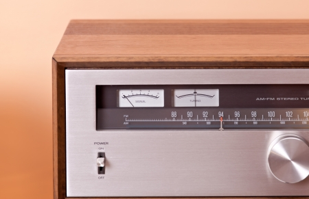 Vintage hi-fi Stereo Tuner in wooden cabinet, front photo