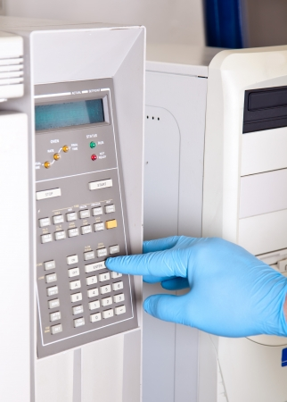 chromatograph: Scientist sets chromatograph oven temperature