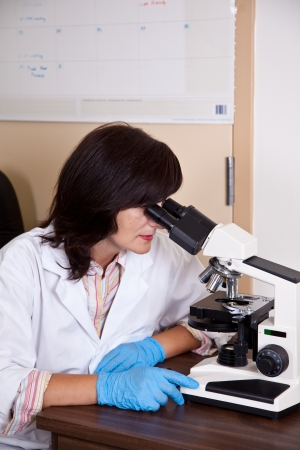 pharmacologist: Scientist works with microscope
