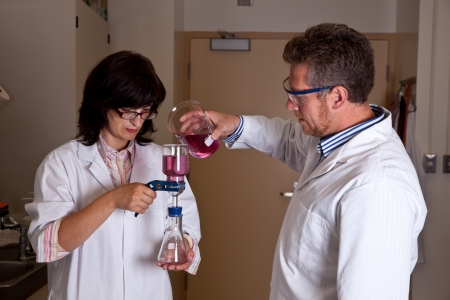analytical: Scientists perform filtration test