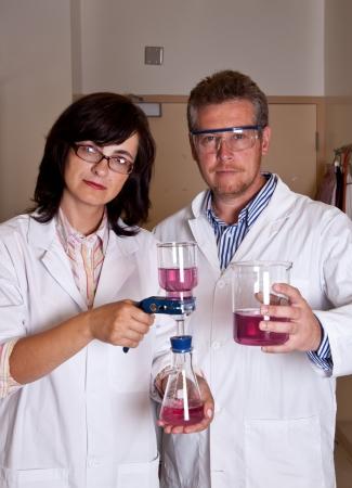 laboratory labware: Scientists perform filtration test