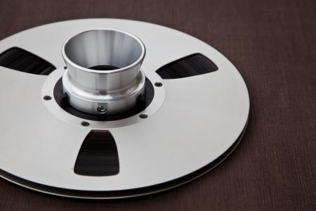 Professional audio metal reel on brown background  免版税图像