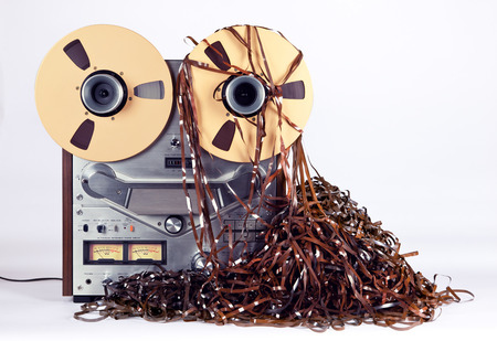 entangled: Open Reel Tape Deck Recorder Player with Messy Entangled Tape Stock Photo