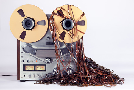 antique: Open Reel Tape Deck Recorder Player with Messy Entangled Tape Stock Photo