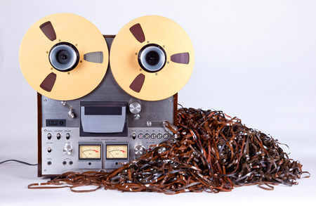 wasted: Open Reel Tape Deck Recorder Player with Messy Entangled Tape Stock Photo