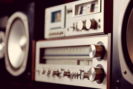 angled view: Vintage audio stereo rack with cassette tape deck receiver and speaker, angled view