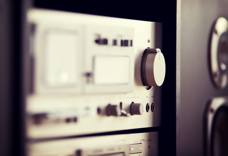 angled view: Stereo Audio Music Rack Component Control Knob Closeup Blurred Stock Photo