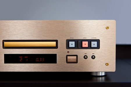 expensive: Expensive CD Player Playing Music with Golden Front Panel Stock Photo