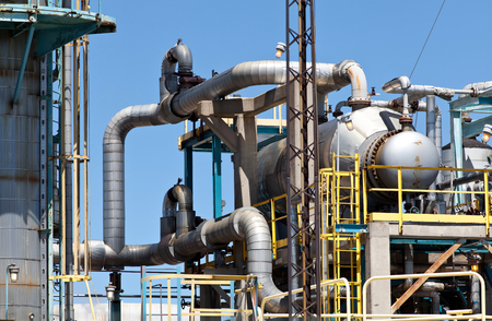 pipeline: Refined Petroleum Petrochemical Plant Smokestack Pipeline with blue sky Stock Photo