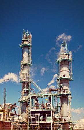 refined: Refined Petroleum Petrochemical Plant Smokestack Rusty Pipeline