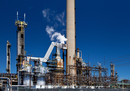Refined Petroleum Petrochemical Plant Smokestack Pipeline with blue sky Stock Photo