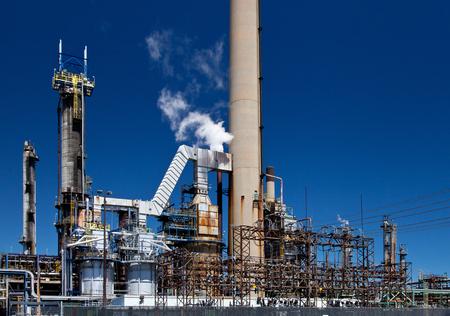 smokestack: Refined Petroleum Petrochemical Plant Smokestack Pipeline with blue sky Stock Photo