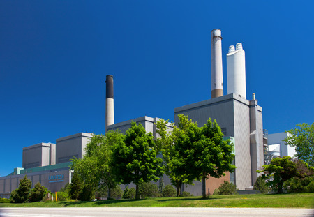 fueled: Coal fueled electricity power plant generation station building with smokestack perspective view