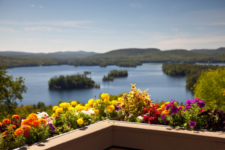 balcony: Beautiful colorful view on the mountains lake from balcony with yellow and red flowers