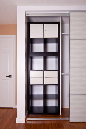 Built In Closet With Sliding Door Shelving Storage Organization Solution,  Empty Shelves Stock Photo