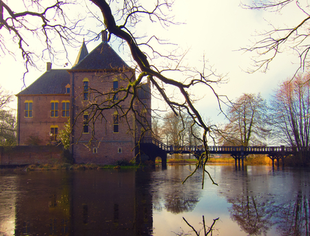 fastness: Ancient medieval stone fortress surrounded by water channel, castle Vorden, Netherlands, Europe