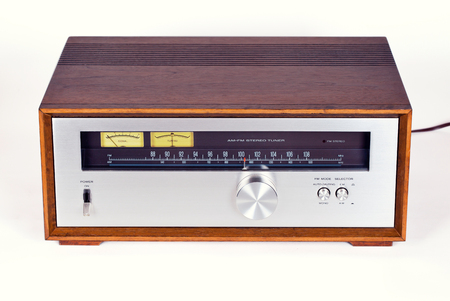 Vintage Stereo Audio Tuner Radio in Wooden cabinet on white background, frontal view Reklamní fotografie