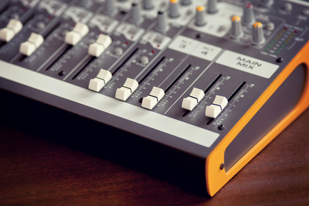 Audio studio sound mixing equalizer equipment board sliders and faders, side view Stock Photo