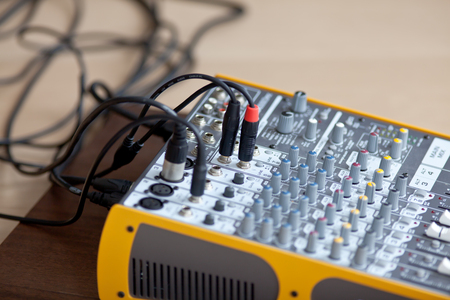 Audio studio sound mixing equalizer equipment board with wires, side view Stock Photo
