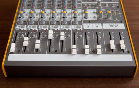 Audio studio sound mixer equalizer board faders sliders, top frontal view