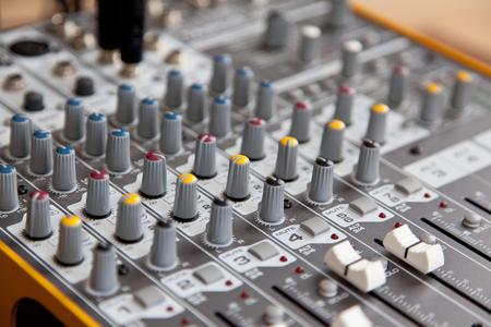 Audio studio sound mixer equalizer board controls, top view closeup