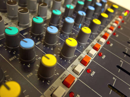Audio mixing console board knobs and buttons closeup