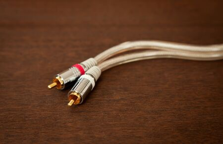 Component Inter Connect Audio Wire Cable with RCA Male Plug on Wooden Desk