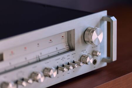 Vintage Stereo Receiver Standing on the Wooden Sideboard, Side View