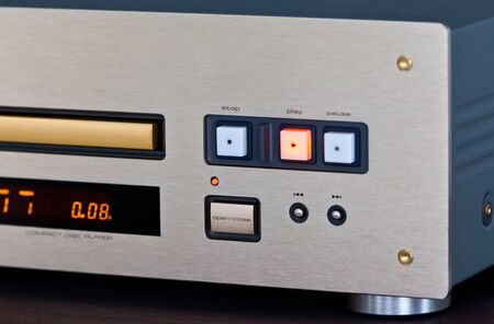 Expensive Stereo CD Player with Golden Front Panel Plays Music on Compact Disk