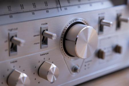 Vintage Audio Stereo Receiver Huge Shiny Metal Volume Knob Closeup Banco de Imagens